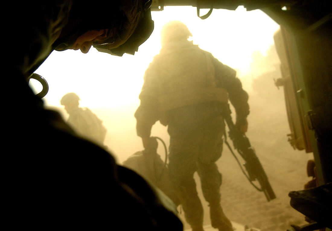 Back at base, SPC Jeffery Moore from Bravo Company, 2nd Battalion, 6 Infantry Regiment, 1st Armored Division, Baumholder, Germany, prepares to exit a Bradley after conducting an early morning raid, looking for weapon caches, on a local school and several houses in the Tameem district of Ramadi, Iraq on September 02, 2006 during Operation Caribbean Stud. No significant evidence was found. — © TSgt Jeremy Lock/