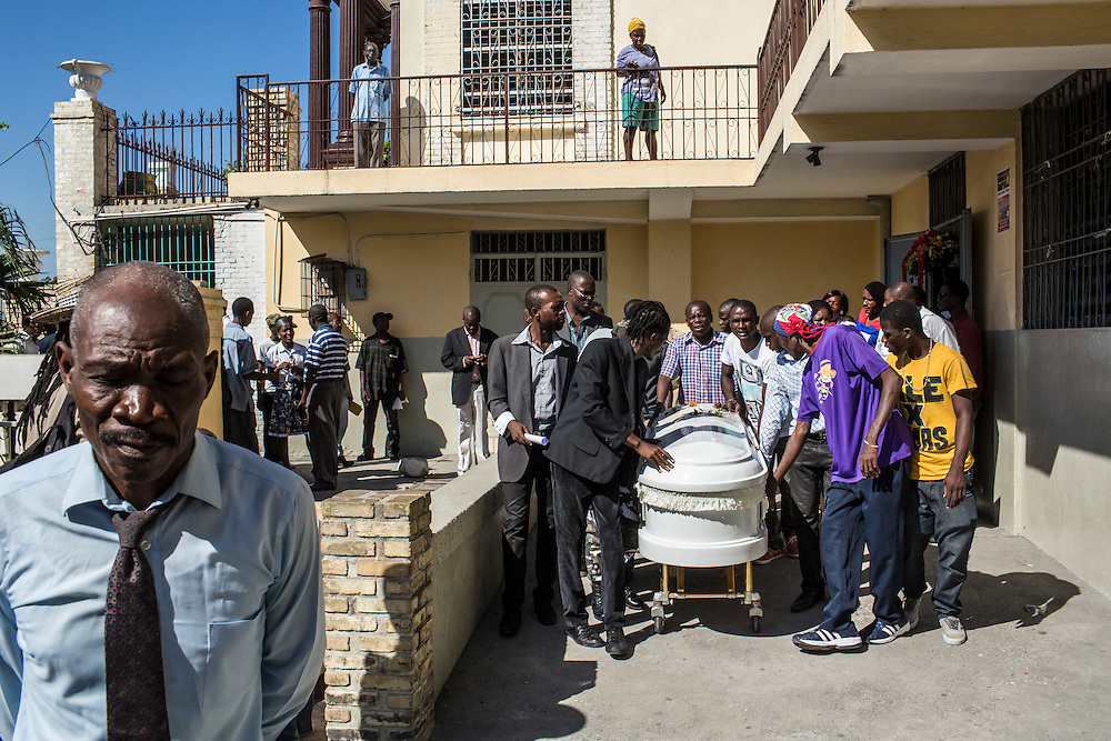 Mourners carry the casket of Jolin Nicolas, 19, on Monday, December 22, 2014 in Port-au-Prince, Haiti. Nicolas was killed by police while participating in anti-government protests on December 13, and many of the mourners came from political groups such as MOPOD, a block of opposition political parties, and Klere J'aie Ayiti that are aligned against President Michel Martelly.