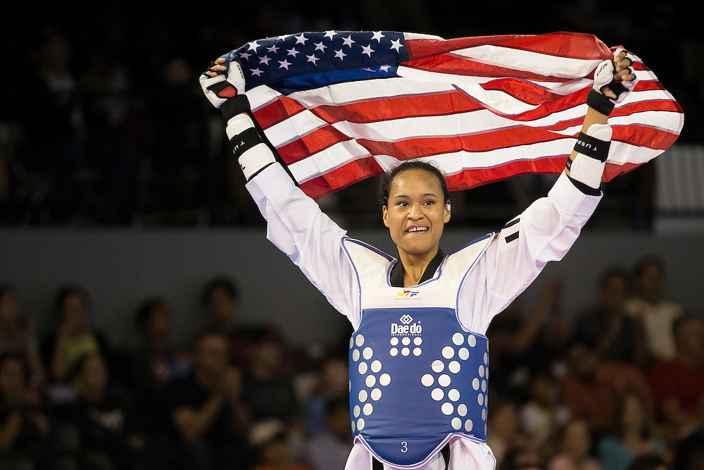 Gold medalist Paige McPherson of the United States celebrates her victory over Victoria Heredia of Mexico in their gold medal contest in women's taekwondo -67 kg division at the 2015 Pan American Games in Toronto, Canada, July 21,  2015.  AFP PHOTO/GEOFF ROBINS