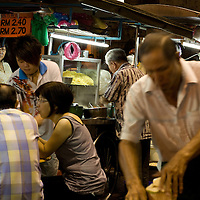 Cruising the nighttime hawker food offerings on Chulia Street.