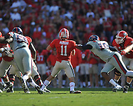 Ole Miss defensive end C.J. Johnson (10) sacks Georgia quarterback Aaron Murray (11) at Sanford Stadium in Athens, Ga. on Saturday, November 3, 2012.