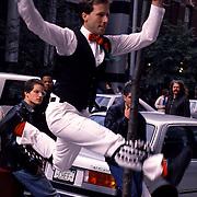 Morris dancer Alex Naar performing in Greenwhich Village, New York City in 1989.  Taken with a 35 mm Nikon FM.