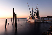 NC00854-00...NORTH CAROLINA - Fishing boat docked in Core Sound, White Oak River Basin, on Oyster Creek along Highway 70 near the town of Davis.