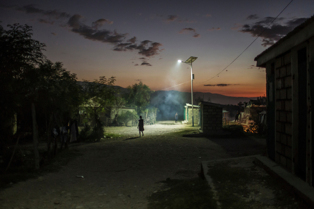 A solar-powered street light illuminates the Corail-Cesselesse camp for people displaced by the 2010 earthquake on Saturday, December 20, 2014 in Port-au-Prince, Haiti. The batteries for the lights are wearing out, and many do not last for more than a few hours. The camp is home to tens of thousands of people, for most of whom there is no work or easy access to the center of town, some 18 kilometers away.