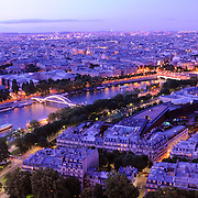 Fantastic view to Paris from Eiffel Tower to Seine river and buildings in illumination