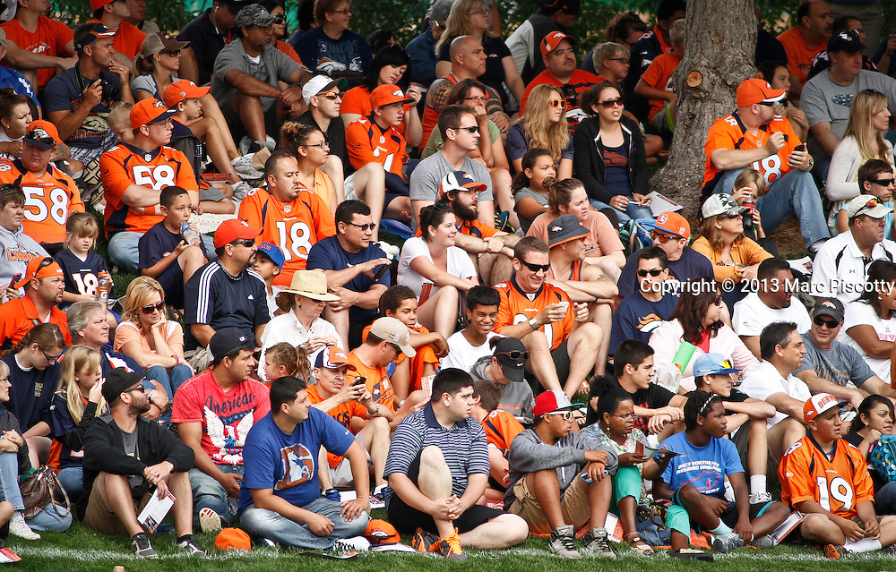 SHOT 7/25/13 9:25:58 AM - Denver Broncos fans watch as the team runs through drills during opening day of the team's training camp July 25, 2013 at Dove Valley in Englewood, Co.  (Photo by Marc Piscotty / © 2013)