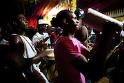 Dominican Republic: Musicians prepare and perform at the compound of Bleo, a Vodú  priest and head of El GaGá de San Luis on the outskirts of Santo Domingo...Musicians play instruments traditionally found in West Africa.