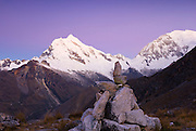 Sunset on the west face of Chopicalqui 6,354m with the southwest ridge on the right skyline, and the north face of Huascarán Sur (South) 6,768m (right).  Viewed from Pisco Base Camp 4,700m. Huascarán National Park, Cordillera Blanca, Peru.  Nikon D200, 17-50/2.8. ND grad filter.
