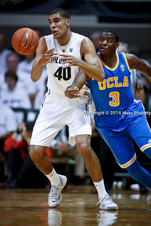 SHOT 1/16/14 8:04:05 PM - Colorado's Josh Scott #40 has the ball tipped from his grasp by UCLA's Jordan Adams #3 during their regular season Pac-12 Conference basketball game at the Coors Events Center in Boulder, Co. UCLA won the game 69-56.<br /> (Photo by Marc Piscotty / &copy; 2014)