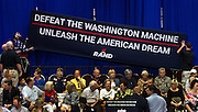 Supporters attempt to hang a sign evenly as Republican presidential candidate U.S. Sen. Rand Paul (R-KY) makes a campaign stop in Las Vegas at the Desert Vista Community Center in Sun City Summerlin on Saturday, April, 11, 2015.