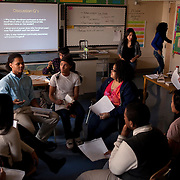 Peer leader Brander Suero, 16, left, during an open discussion in AP English class at Central Park East High School in New York, NY on November 15, 2012. Beyond sheer physical safety, a look at how schools and districts can create classroom conditions in which students are able to engage enthusiastically and without emotional fear of stepping forward. Photographer: Melanie Burford/Prime