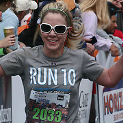 Stacey McNemar (2033) of Wilmington, DE., celebrates finishing the 13th Annual Discover Bank Delaware Marathon Sunday, May 8, 2016, at Tubman Garrett Riverfront Park, in Wilmington Delaware.