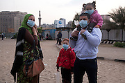An Egyptian family wearing hospital masks on their faces to protect themselves from tear gas in Tahrir Square  in Cairo November 21, 2011. Protestors clashed with riot police for a third day as thousands of people packed Tahrir Square, the epicenter of the anti-Mubarak revolt in January and February, as darkness fell, despite the clashes that threaten to disrupt Egypt's first free election in decades, due to start next week.  (Photo by Heidi Levine/Sipa Press).