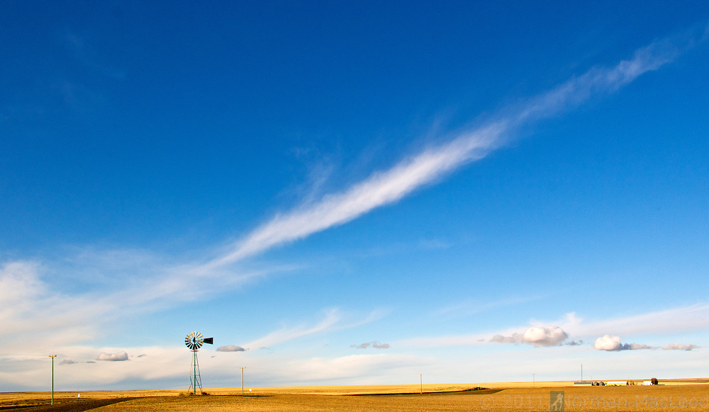 Windmill against a winter afternoon sky in eastern Washington