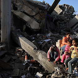 Palestinian children are seen sitting outside of their home, which was destroyed by Israeli artillery fire, Beit Hanoun, Gaza Strip, Palestinian Territories, Nov. 15, 2006. According to Human Rights Watch, since September 2005, Israel has fired about 15,000 rounds at Gaza while Palestinian militants have fired around 1,700 back.