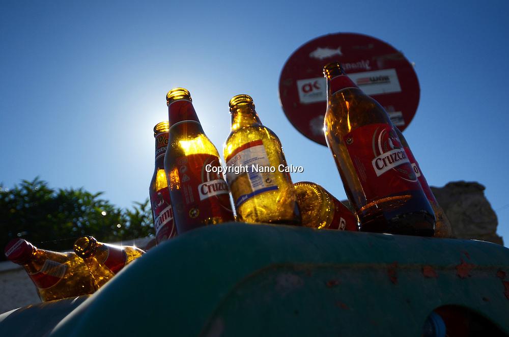 Used beer bottles in trash bin