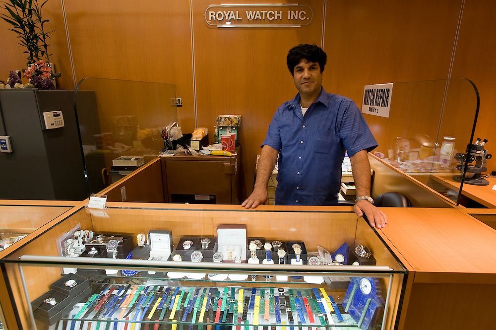 The Afghan Farid Watchmaker at his 'Royal Watch' booth at Fifth Avenue Jeweler Exchange...Diamond District New York on 47th street between 5th and 6th avenues in midtown Manhattan . The Diamond District is the world's largest shopping district for all sizes and shapes of diamonds and fine jewelry. Many suppliers and jewelry makers also have their stores and workshops right on 47th street.