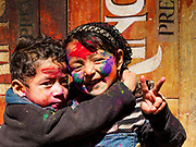 12 MARCH 2017 - BHAKTAPUR, NEPAL:  A Nepali brother and sister after a Holi celebration in Bhaktapur. Holi, a Hindu religious festival, has become popular with non-Hindus in many parts of South Asia, as well as people of other communities outside Asia. The festival signifies the victory of good over evil, the arrival of spring, end of winter, and for many a festive day to meet others. Holi celebrations in Nepal are not as wild as they are in India.    PHOTO BY JACK KURTZ