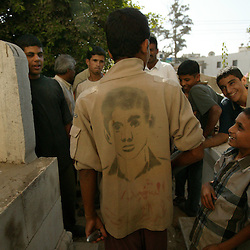 A young man, whose cousin died as a martyr for the Palestinian cause, visits the graves of Anam and Abdul Rahman Al Qedua, Yasser Arafat's sister and father respectively, Khan Yunis, Palestinian Territories, Nov. 9, 2004.  Arafat was diagnosed with liver failure while in critical condition in a Paris hospital.