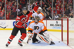 Mar 13, 2013; Newark, NJ, USA; New Jersey Devils left wing Patrik Elias (26) celebrates his goal scored on Philadelphia Flyers goalie Ilya Bryzgalov (30) during the first period at the Prudential Center.