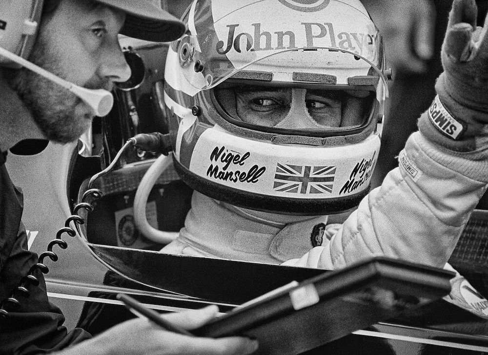 Great Britain's Lotus F1 driver Nigel Mansell listens to pre-race instructions before the start of the 1982 Detroit Grand Prix. <br />