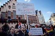Frankfurt am Main | 30 Mar 2015<br /> <br /> Am Montag (30.03.2015) demonstrierten etwa 40 Menschen unter dem Namen &quot;Freie B&uuml;rger f&uuml;r Deutschland&quot; auf dem R&ouml;merberg in Frankfurt am Main gegen Islamisierung und zahlreiche andere &Uuml;bel, die Gruppe war zuvor unter dem Namen &quot;PEGIDA&quot; aufgetreten. Etwa 600 Menschen protestierten lautstark gegen diese Kundgebung.<br /> Hier: Gegendemonstranten mit mit einem Plakat mit der Aufschrift &quot;Alle Menschen sind gleich - Nur Schweine sind gleicher&quot; vor dem R&ouml;mer.<br /> <br /> &copy;peter-juelich.com<br /> <br /> [No Model Release | No Property Release]