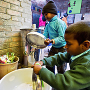 In this Indian school, the NGO Duniya educates children to wash teir own plates after having their daily warm meal (lunch) in the school.