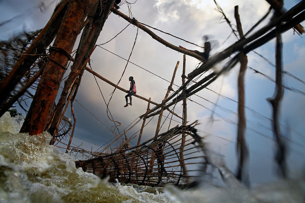 Fishermen navigate wooden frames over Wagenia Falls (or Boyoma Falls) on the left bank of the Congo River, near Kisangani, DR Congo. The left bank consists of largest series of wooden frames stretching across a fast body of water.