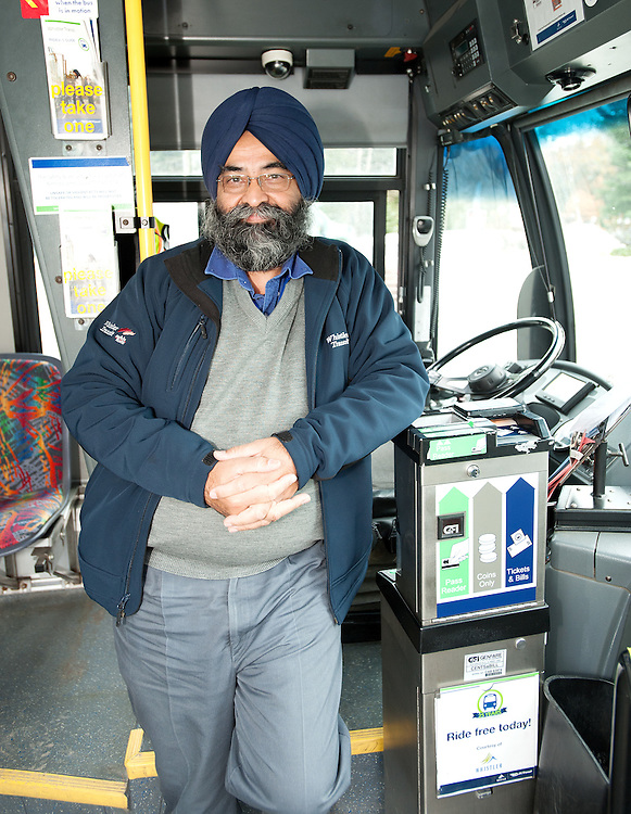 Long time local bus driver Jatinder Dhaliwal  25th anniversary of Whistler Transit, who are offering free transit all day.  Thursday, Dec 1, 2016.<br /> <br /> Photo:  David Buzzard