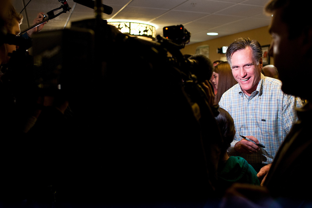 Republican presidential candidate Mitt Romney meets with voters at the Stoney Creek Inn on Saturday, December 31, 2011 in Sioux City, IA.