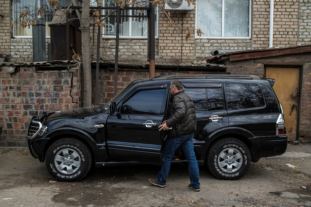 Oleg Zinchenko, a local businessman who has been helping people displaced by fighting in Eastern Ukraine, gets into his car on Wednesday, October 15, 2014 in Berdyansk, Ukraine. Photo by Brendan Hoffman, Freelance