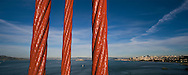 A sunset panoramic view from the Golden Gate Bridge of Alcatraz, the San Francisco bay and downtown San Francisco.