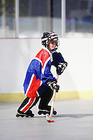 1998: Model Released action photos of boys playing roller hockey on concrete floor.  7 year old Cooper Watson inline skating with stick, puck, helmet and uniform.   Transparency slide scan.