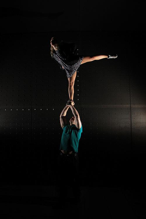 Single based arabesque partner stunt, two of camera flashes, taken in Leeds city centre.