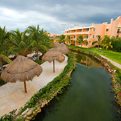 Storm clouds gather over a resort in the Mexican Riviera Maya.