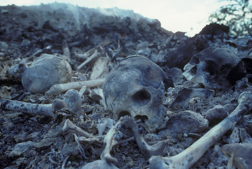 Haiti, Port-au-Prince, Burned human skull in graveyard reportedly used as body dump by Tonton Macoute