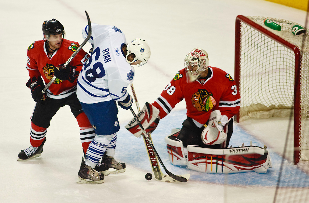 London, Ontario ---10-09-11--- Leaf's rookie Kenny Ryan tries to tip the puck past Chicago Blackhawks goaltender Alex Richards during the Leaf's first game of the 2010 Rookie Tournament at the John Labatt Centre in London, Ontario, September 11, 2010.<br /> GEOFF ROBINS Toronto Star