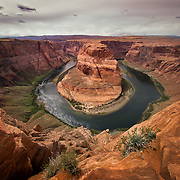 USA, Southwest, West, AZ, Arizona, Colorado River, Horseshoe Bend, The Colorado River twists into a complete turn around this unique red rock formation near Page, AZ.