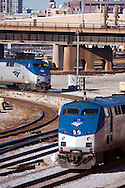 Two Amtrak locomotives meet in their coach yards in Chicago, IL.