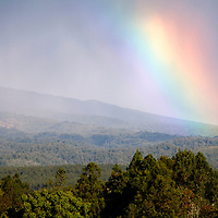 Africa, Kenya, Nanyuki. Rainbow over the landscape of Mt. Kenya Safari Club.