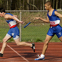 Times Herald-Record/TOM BUSHEY.Goshen's Joe Russo, left, and Jerrell Graver loose control of the baton on in the 400-meter relay yesterday during a meet against Monticello and Chapel Field in Goshen..April 27, 2005.