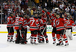 Feb 9, 2009; Newark, NJ, USA; The New Jersey Devils congratulate goalie Scott Clemmensen (35) and give him the game puck after Clemmensen's 3-0 shutout win over the New York Rangers at the Prudential Center.