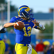 Delaware quarter back Trent Hurley #12 attempts to throw a pass in the pocket during a Week 6 NCAA football game against Maine University.
