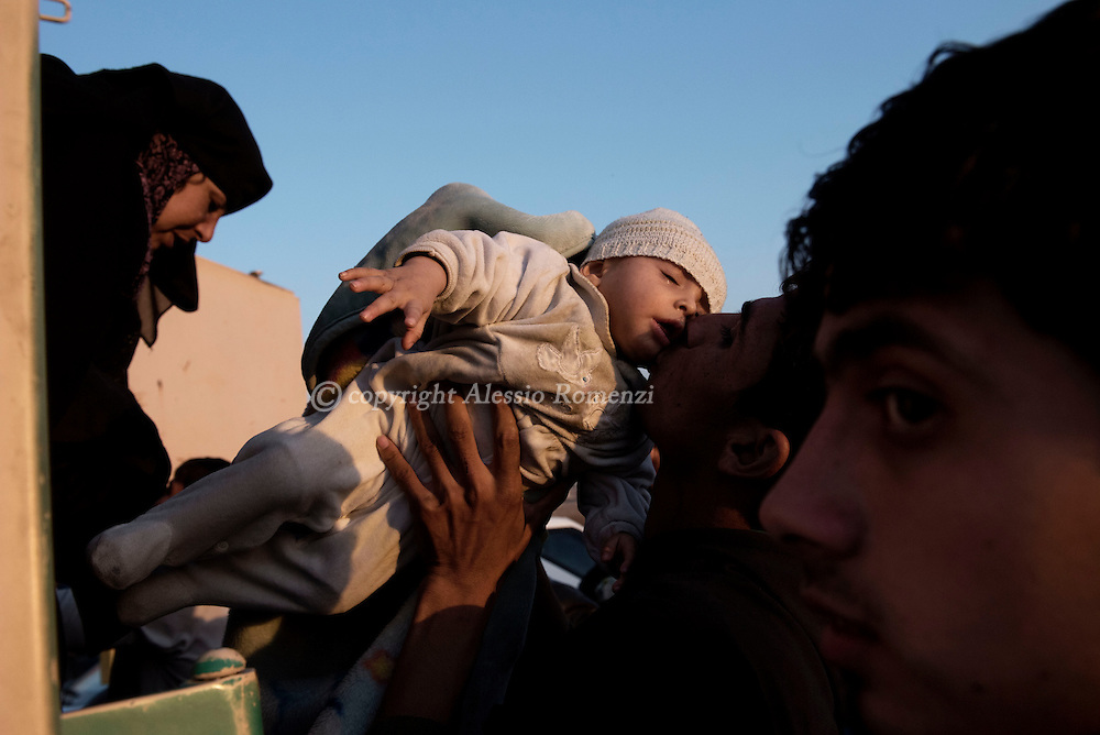 Iraq: Civilians are assisted as they arrive by truck at the entrance of the Hasan Sham IDP camp in Al Kazir area after fleeing fighting in Mosul on November 5, 2016. Alessio Romenzi