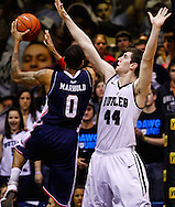 INDIANAPOLIS, IN - FEBRUARY 19: As Andre Marhold #0 of the Duquesne Dukes shoots the ball Andrew Smith #44 of the Butler Bulldogs defends at Hinkle Fieldhouse on February 19, 2013 in Indianapolis, Indiana. Butler defeated Duquesne 68-49. (Photo by Michael Hickey/Getty Images) *** Local Caption *** Andre Marhold; Andrew Smith
