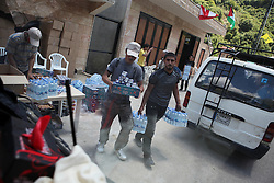 Along the three-hour bus ride from Beirut to Maroun al-Ras, Hizballah volunteers pass out water, juice and snacks to the hundreds of buses heading to the right of return protest from across the country.