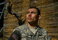 U.S. Army Private Jonathan Frank finishes repelling down a tower during basic military training at Fort Jackson, S.C., on October 23, 2008.