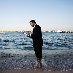 Precious' script writer Geoffrey Fletcher, shot bare foot at the International Village's beach, 62th Cannes Film Festival. France. 18 May 2009. Photo: Antoine Doyen