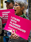 04 MAY 2017 - ST. PAUL, MN: A woman calls for access to reproductive health care during a rally to protect women's access to health care at the Minnesota Capitol. About 50 people came to a protest to urge Minnesota State Senators to vote against two bills supported by the Republican party that would restrict access to women's health care in Minnesota. The protest was organized by  NARAL Pro-Choice Minnesota, NCJW Minnesota, and Planned Parenthood Minnesota. The Senate passed the bills but Minnesota's Democratic governor is expected to veto the legislation when it reaches his desk.     PHOTO BY JACK KURTZ
