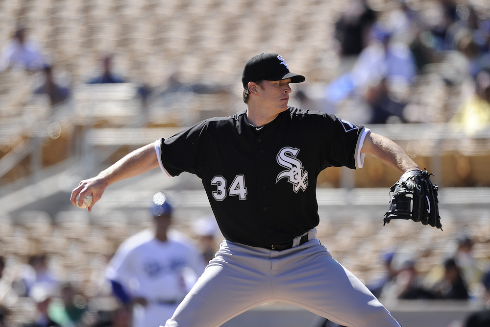 GLENDALE, AZ - FEBRUARY 28:  Gavin Floyd #34 of the Chicago White Sox pitches during the game against the Los Angeles Dodgers on February 28, 2011 at The Ballpark at Camelback Ranch in Glendale, Arizona. The Dodgers defeated the White Sox 6-5.  (Photo by Ron Vesely)